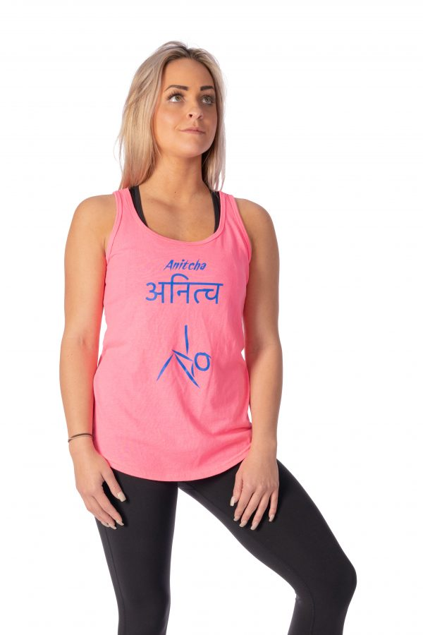 A model wearing a pink fitness tank top from Thomas Michael Fashions