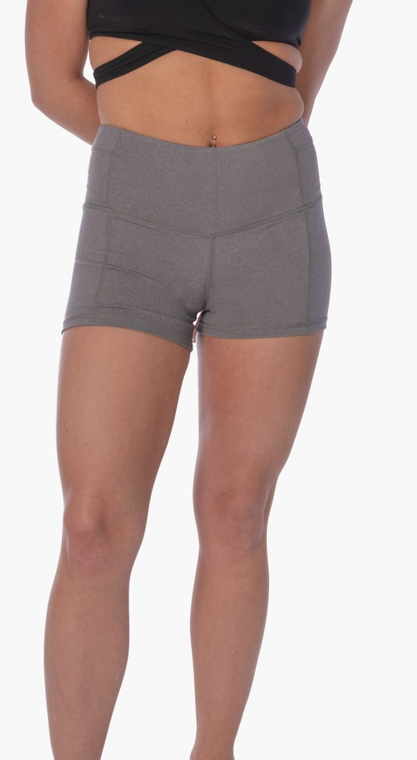 A model wearing gray high-waisted yoga shorts from Thomas Michael Fashions