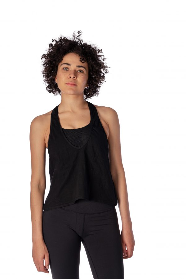 A model wearing a black open back yoga top from Thomas Michael Fashions