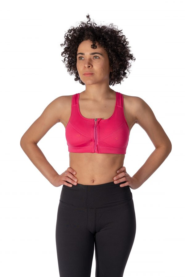 A model wearing a pink zipper front yoga sports bra from Thomas Michael Fashions